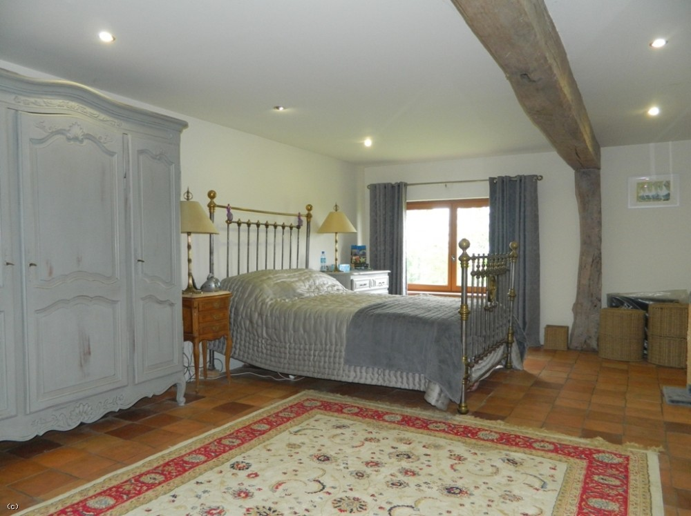 Restored farmhouse with large barn, superb views and 13ha